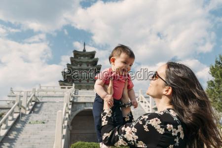 south korea seoul happy woman holding