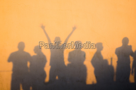 shadows of people at sunset on