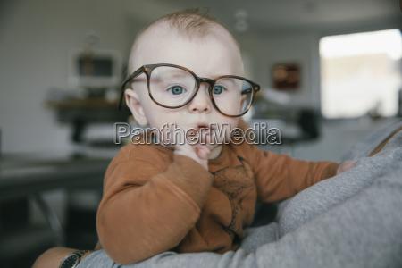 baby boy wearing oversized glasses