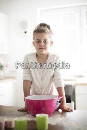 portrait of little girl baking in