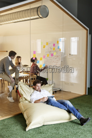 man in office using tablet in