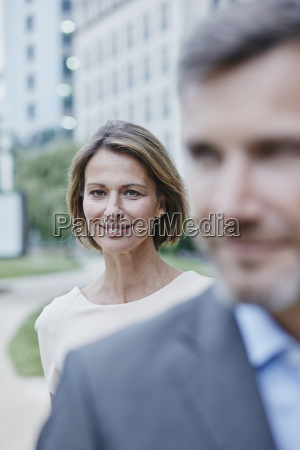 portrait of confident businesswoman and businessman