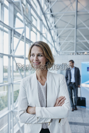 smiling businesswoman at the airport looking