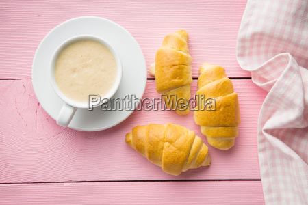 sweet tasty croissants and coffee cup