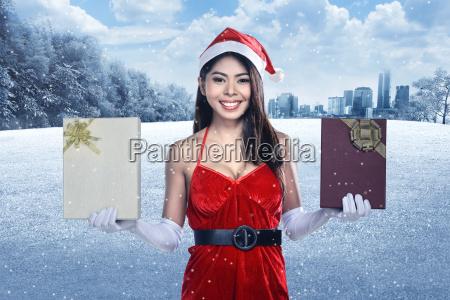 beautiful, asian, santa, woman, holding, gift - 22752935