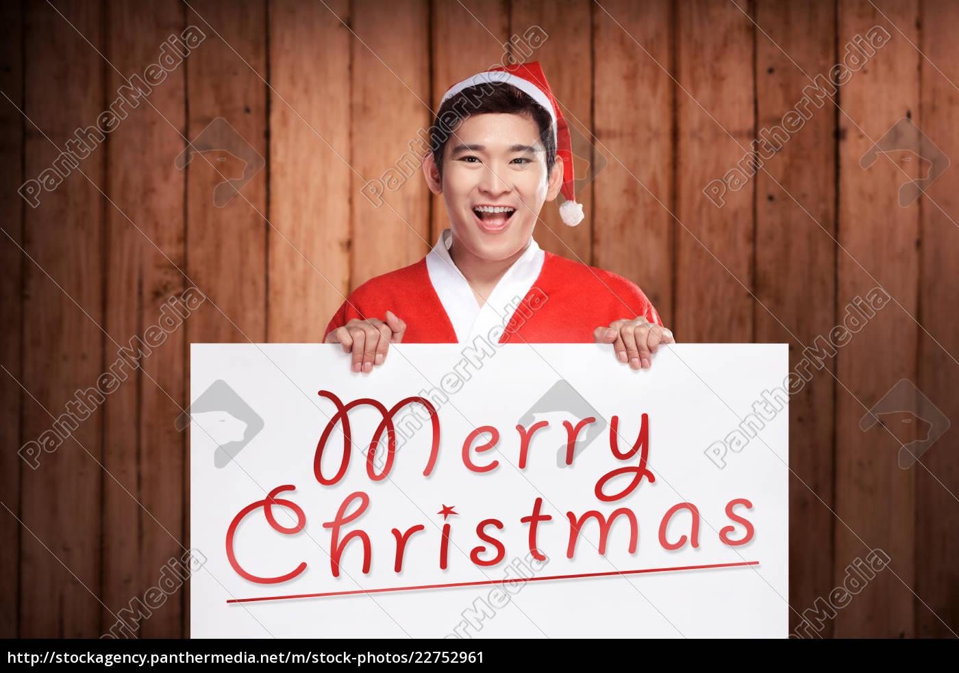 man, wearing, santa, claus, costume, holding - 22752961