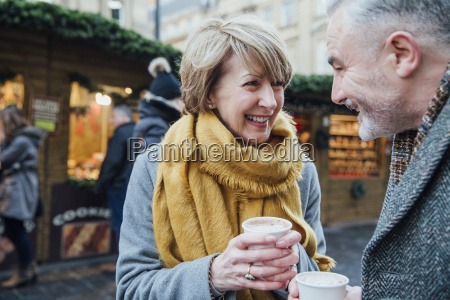 enjoying coffee at the christmas market