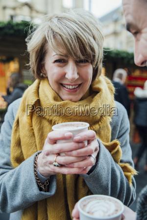 mature woman drinking hot chocolate at