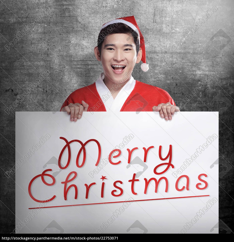 man, wearing, santa, claus, costume, holding - 22753071