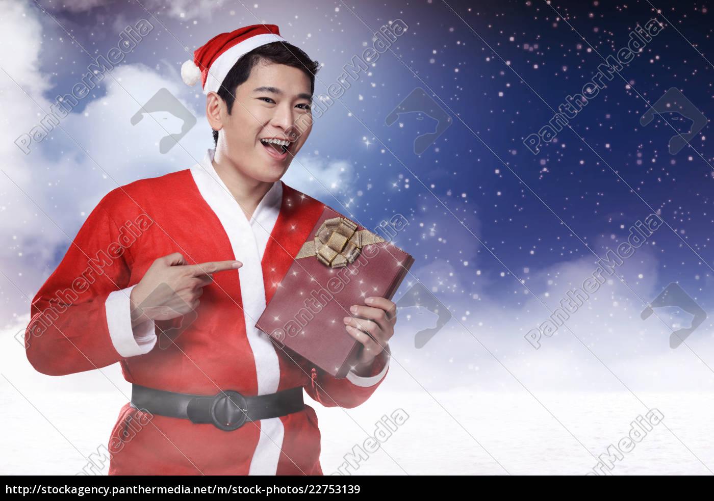 man, wearing, santa, claus, costume - 22753139