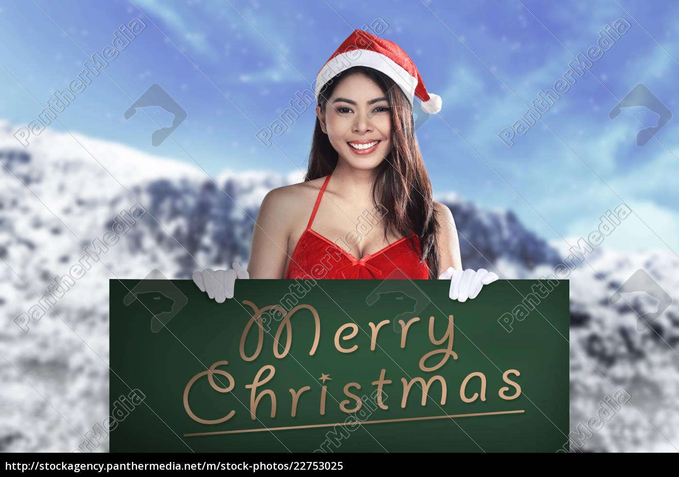 santa, woman, holding, merry, christmas, board - 22753025