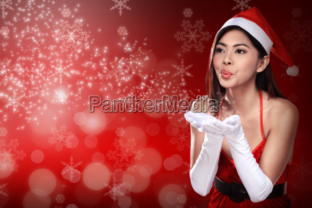asian woman in santa claus costume