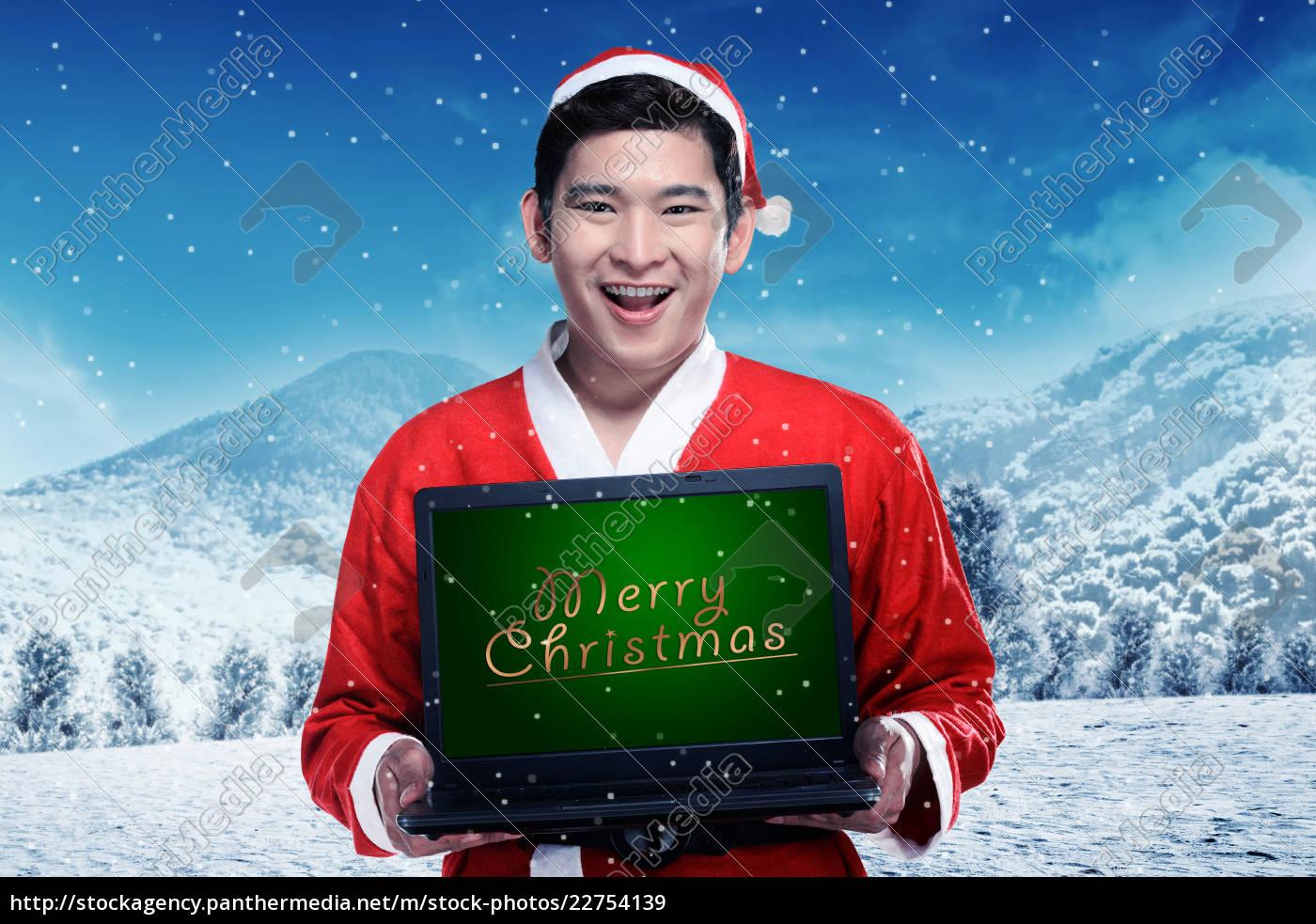 asian, man, in, santa, claus, costume - 22754139