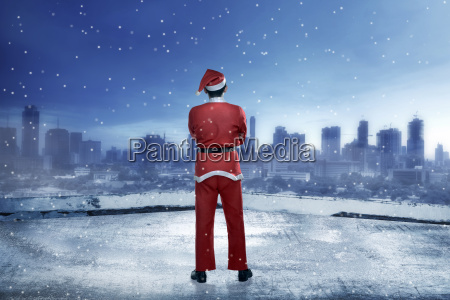 asian, man, wearing, santa, claus, costume - 22754215