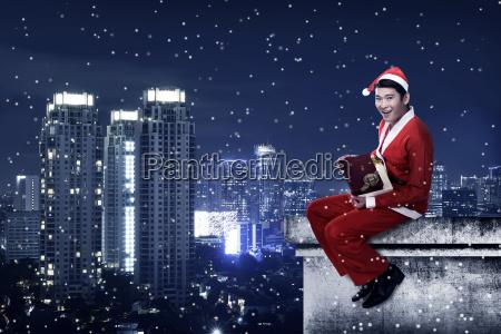 asian, man, wearing, santa, claus, costume - 22754611