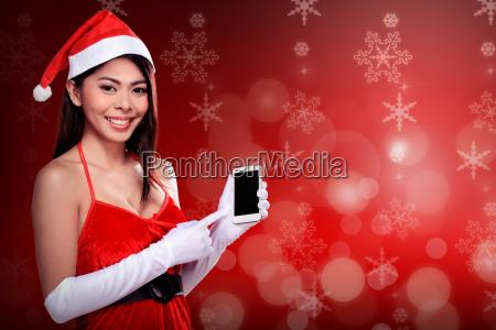 asian, woman, in, santa, claus, costume - 22754577