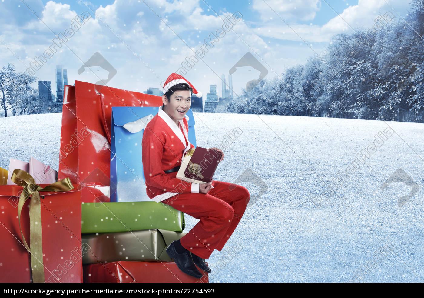 young, asian, man, in, santa, costume - 22754593