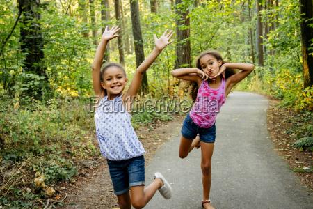 mixed race sisters having fun posing
