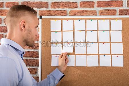businessman, looking, at, notes - 22763815