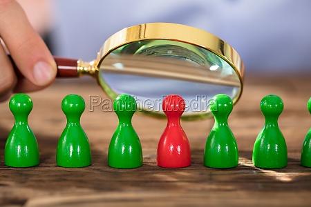 person, examining, the, plastic, figures - 22763771