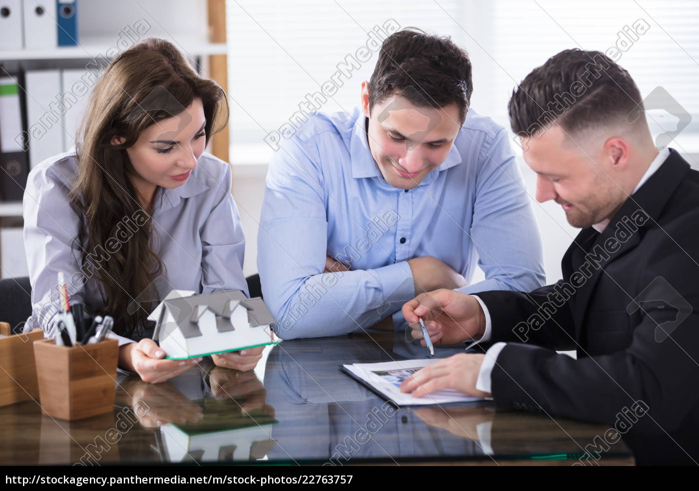 real, estate, agent, meeting, with, couple - 22763757