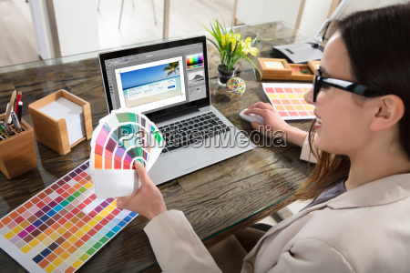 designer holding colour swatches in her