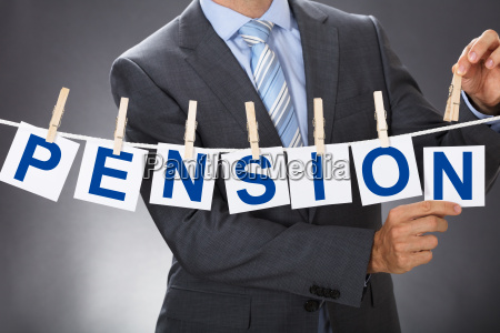 businessman pinning pension cards on clothesline