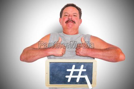 man with blackboard hashtag icon