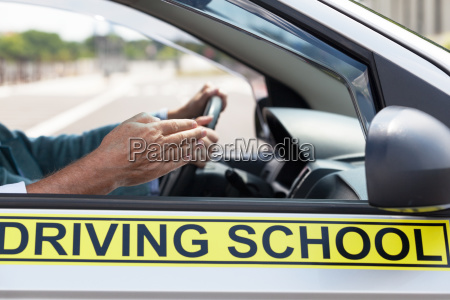 learner driver student driving car with