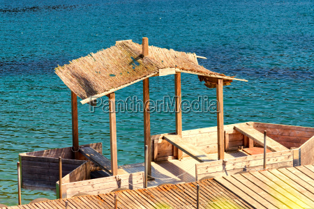 boat jetty with wooden boat and