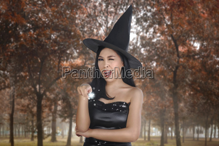 beautiful, asian, witch, woman, with, hat - 22799506