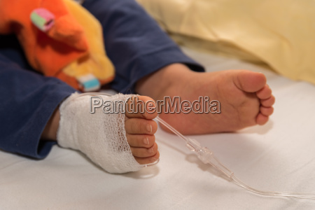 child gets infusion closeup cannula