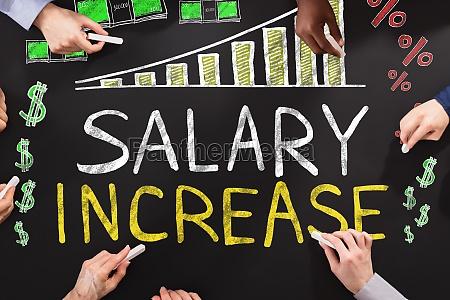 salary increase drawing on blackboard