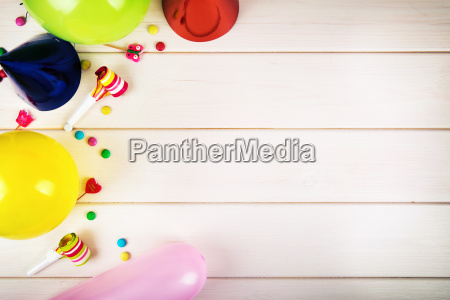 colorful birthday party items with copy