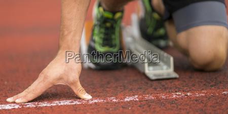 detail of sprint start in athletics