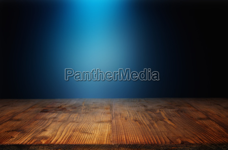 wooden table with blue light beam