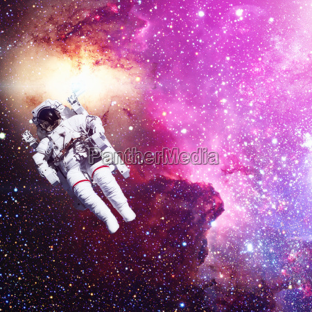astronaut in outer space nebula and