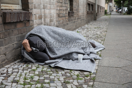 homeless man sleep on street