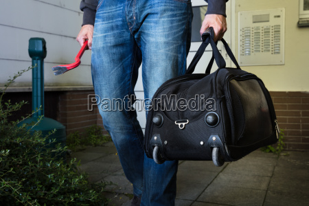 robber with steal handbag from home