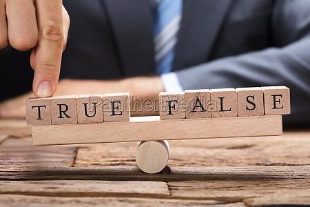 businessman with true and false blocks