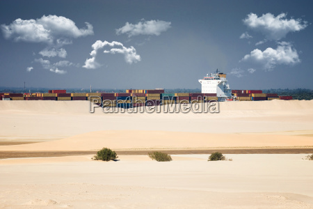 desert ship container ship sails