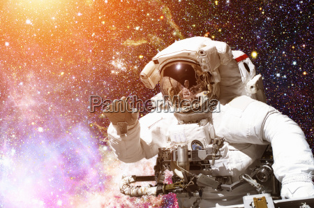 astronaut in outer space galaxy and