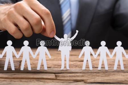 businessman holding successful paper executive amidst