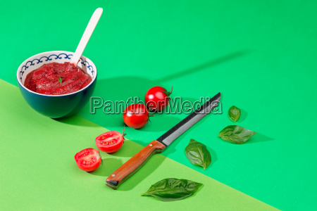 bowl of chopped tomatoes on green