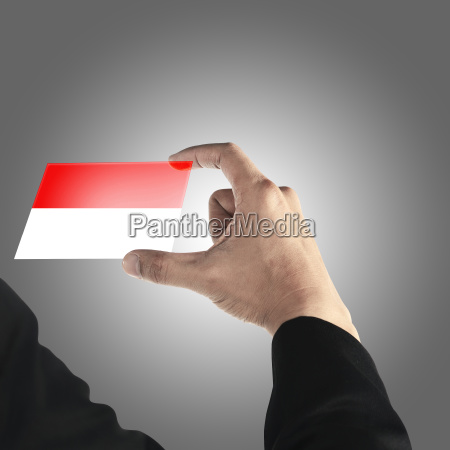 man hold indonesian card