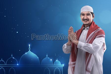 young asian muslim man wearing cap