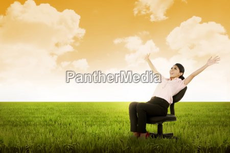 business woman sitting on chair on