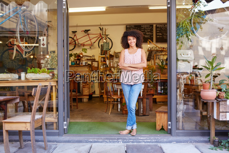 woman standing happily in the entrance