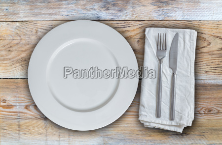 empty plate with cutlery on untreated