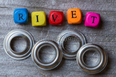 rivet cubes and rivets on gray